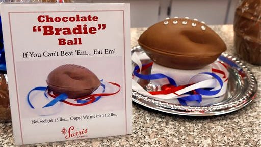 """A """"deflated"""" chocolate football called a """"Bradie"""" Ball is on display at Sarris Candy store in in Canonsburg, Pa., on Wednesday, Jan. 28, 2015. Owner Bill Sarris says they came up with the idea to poke fun at the controversy surrounding under-inflated footballs on Tuesday."""