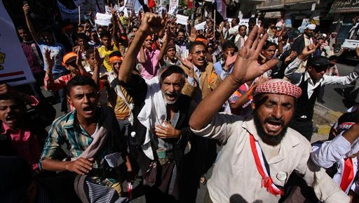 Yemeni protesters shout slogans against Houthi Shi'ite rebels who have seized power in the capital, Sanaa, as they celebrate the fourth anniversary of the Arab Spring uprising in Taiz, Yemen, on  Wednesday, Feb. 11, 2015. The U.S., Britain and France have closed their embassies in Yemen because of the political chaos.