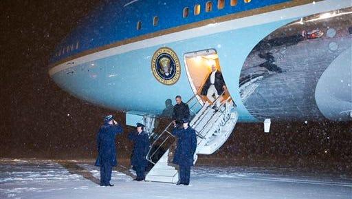 President Barack Obama steps off Air Force One after arriving at Andrews Air Force Base, Md., Monday, Feb. 16, 2015.