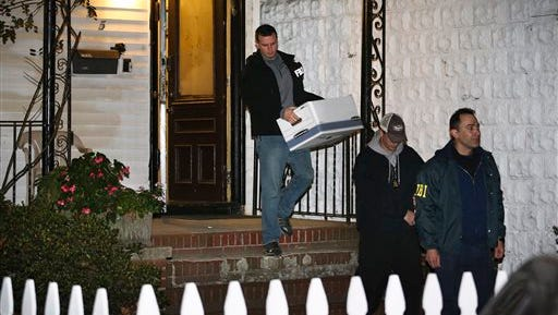 In a 2013 file photo, FBI agents remove evidence from the Brooklyn residence of Rabbi Mendel Epstein during an investigation, in New York. Several defendants, including Epstein and another rabbi, are accused by the FBI of plotting to kidnap and beat a man to force him to grant a religious divorce. Epstein's trial started Tuesday in federal court in New Jersey. Several co-defendants have pleaded guilty and others will join him in court this week.