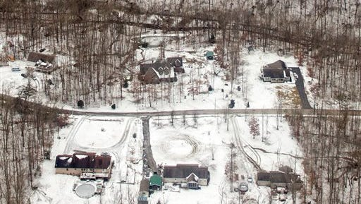 Ice and snow are seen near homes from a National Guard helicopter on the Cumberland Plateau near Crossville on Feb. 24. Tennessee Gov. Bill Haslam joined state officials in touring damage from the storm, and urged people to check on their neighbors as the death toll from the storm climbed.