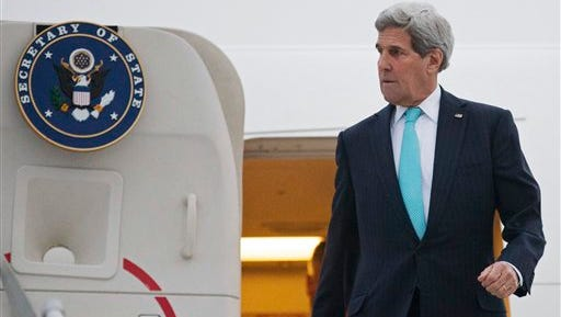 U.S. Secretary of State John Kerry disembarks from his plane as he arrives in Geneva, Switzerland, Sunday March 15, 2015. Kerry is in Geneva to resume talks with Iranian officials to limit Tehran's most sensitive nuclear activities for at least 10 years in exchange for the gradual easing of some sanctions.  (AP Photo/Brian Snyder, pool)