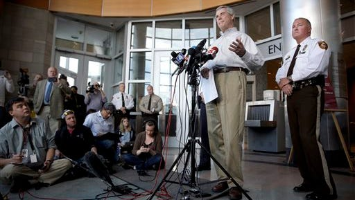 St. Louis County Prosecutor Robert McCulloch, left, speaks during a news conference as St. Louis County Police Chief Jon Belmar listens Sunday, March 15, 2015, in Clayton, Mo. McCulloch said 20-year-old Jeffrey Williams has been charged with two counts of first-degree assault in the shooting of two St. Louis-area officers. (AP Photo/Jeff Roberson)