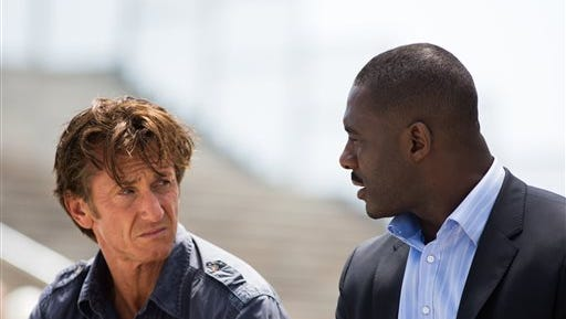 """This image released by Open Road Films shows Sean Penn, left, and Idris Elba in a scene from """"The Gunman."""" (AP Photo/Open Road Films, Keith Bernstein)"""
