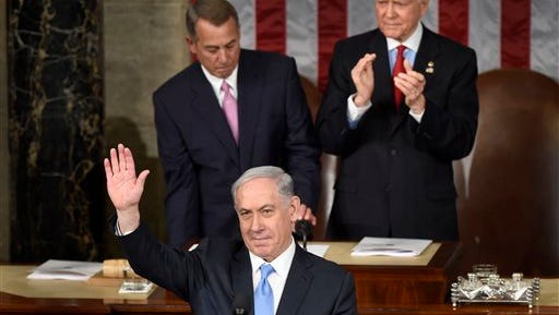 Israeli Prime Minister Benjamin Netanyahu waves as he speaks before a joint meeting of Congress on Capitol Hill in Washington, Tuesday, March 3, 2015. Since Republicans took control of Congress two months ago, an elaborate tug of war has broken out between GOP lawmakers and Obama over who calls the shots on major issues for the next two years. In the course of a few hours Tuesday, House Republicans caved to Obama on Homeland Security funding and immigration. Yet they also antagonized him by giving Israel's prime minister a perch in Congress to rail against nuclear talks with Iran. (AP Photo/Susan Walsh)