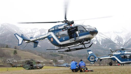 An helicopter takes off at Seyne les Alpes, French Alps, Tuesday, March 24, 2015. A Germanwings passenger jet carrying at least 150 people crashed Tuesday in a snowy, remote section of the French Alps, sounding like an avalanche as it scattered pulverized debris across the mountain. (AP Photo/Claude Paris)