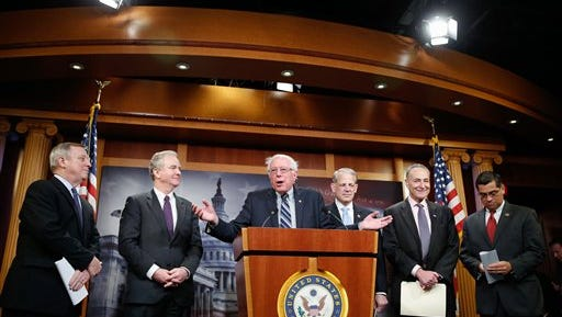 Sen. Bernie Sanders, I-Vt., center, speaks during a news conference on Capitol Hill in Washington, Wednesday, March 25, 2015, to discuss the budget. From left are, Senate Minority Whip Richard Durbin of Ill., Rep. Chris Van Hollen, D-Md., ranking member on the House Budget Committee, Sanders, Rep. Steve Israel, D-N.Y., Sen. Charles Schumer, D-N.Y., and Rep. Xavier Becerra, D-Calif. (AP Photo/Andrew Harnik)