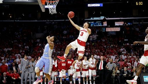 Wisconsin guard Zak Showalter shoots over North Carolina guard Nate Britt during the second half of a college basketball regional semifinal in the NCAA Tournament, Thursday, March 26, 2015, in Los Angeles. (AP Photo/Jae C. Hong)
