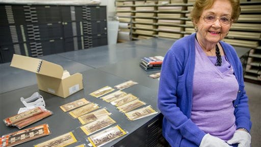 Texas collector Robin Stanford poses with some of her rare Civil War-era stereoscopic photographs at the Library of Congress on Friday, March 27, 2015, in Washington. Stanford has sold the Library of Congress some of her private collection, including a set of very rare photos of pre-Civil War slave life on a South Carolina plantation, and images from Ft. Sumter just after it was seized by the Confederates in April 1861. Stereoscopic photography creates the illusion of three-dimensional depth from two similar two-dimensional photographs taken next to each other.