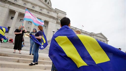 Demonstrators gather on the steps at the Arkansas state Capitol in Little Rock, Ark., Thursday, April 2, 2015. The measure passed in the committee. A reworked religious freedom bill passed earlier in the House Judiciary Committee. (AP Photo/Danny Johnston)