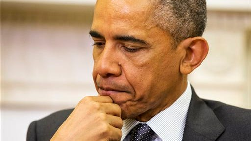 President Barack Obama listens during his meeting with Iraqi Prime Minister Haider Al-Abadi in the Oval Office of the White House in Washington, Tuesday, April 14, 2015. The Prime Minister is visiting to discuss U.S.-Iraq policy and the fight against the IS group. (AP Photo/Jacquelyn Martin)
