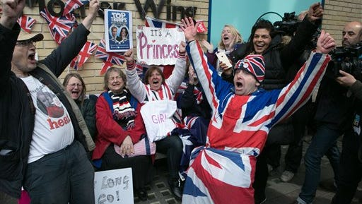 """Royal fans and well wishers react after Kensington Palace announced that Kate, the Duchess of Cambridge, had given birth to a girl, outside the Lindo Wing of St. Mary's Hospital, London, Saturday, May 2, 2015. Kensington Palace said in a brief statement that Prince William's wife """"was safely delivered of a daughter"""" at 8:34 a.m. London time (0734 GMT), less than three hours after she was admitted to central London's St. Mary's Hospital."""