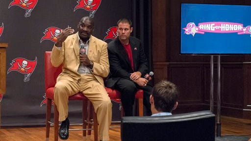 Former Tampa Bay Buccaneers quarterback Doug Williams, left, and former fullback Mike Alstott answer questions from media after their introduction as the newest members of the NFL football team's Ring of Honor, Wednesday, May 13, 2015, in Tampa, Fla. (Michael Bou-Nacklie/Tampa Bay Times via AP)