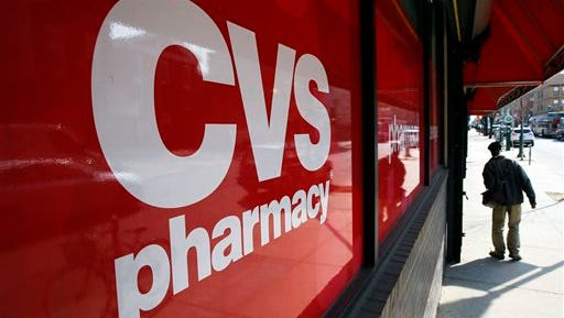 FILE - This March 25, 2014, file photo, shows a CVS store in Philadelphia. CVS Health will buy Omnicare in a deal valued at about $12.7 billion in move to expand its pharmacy services reach into assisted living and senior care facilities. (AP Photo/Matt Rourke, File)