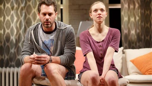 "In this image released by Polk PR, Thomas Sadoski, left, and Amanda Seyfried appear during a performance of Neil LaBute's new play, ""The Way We Get By"", in New York. (Joan Marcus/ Polk PR via AP)"