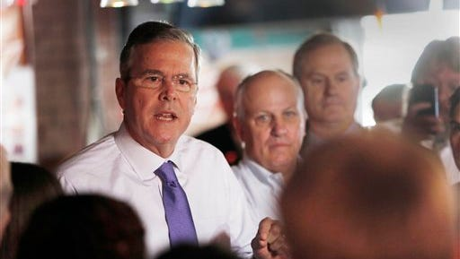 FILE - In this May 21, 2015 file photo, former Florida Gov. Jeb Bush speaks to a morning crowd at the Draft restaurant in Concord, N.H. During his transition from Florida governor to likely presidential candidate, Jeb Bush served on the boards or as an adviser to at least 15 companies and nonprofits, a dizzying array of corporate connections that earned him millions of dollars and occasional headaches.  (AP Photo/Jim Cole, File)