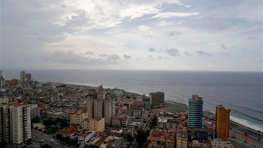 This coastal view of Havana, Cuba shows the United States Interests Section diplomatic mission, the third tall building from the right, on Sunday, May 24, 2015. On Friday, May 29 the Obama administration formally removed Cuba from a U.S. terrorism blacklist as part of the process of normalizing relations between the Cold War foes. (AP Photo/Desmond Boylan)
