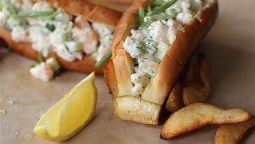 This April 27, 2015 photo shows New England style shrimp rolls in Concord, N.H. (AP Photo/Matthew Mead)