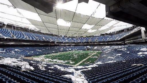 In this May 12, 2014 photo, the interior of the Pontiac Silverdome is seen in Pontiac, Mich. The 80,000-seat indoor stadium hosted the Super Bowl, the NBA finals, the World Cup, Wrestlemania, a papal visit and concerts by Elvis Presley, Led Zeppelin and the Rolling Stones.