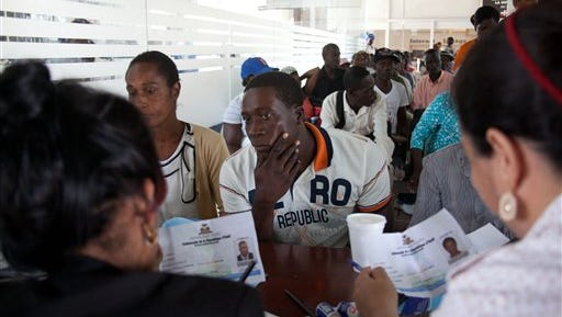 """A Haitian man registers for legal residency at the Interior Ministry in Santo Domingo, Dominican Republic, Tuesday, June 16, 2015. Army Gen. Rubel Paulino says those who haven't registered by Thursday """"will be repatriated,"""" which conflicts with statements by Interior Minister Ramon Fadul that there will be no mass deportations. (AP Photo/Tatiana Fernandez)"""