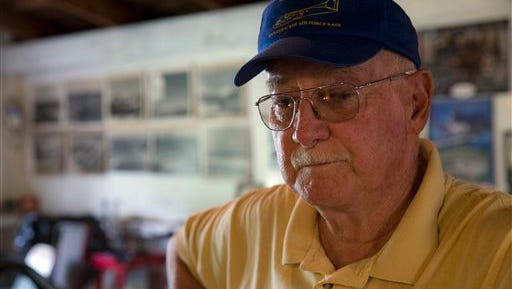Retired Air Force reserve tech Sgt. Ed Kienle, 73, pauses during an interview in his barn, Thursday, June 11, 2015, in Wilmington, Ohio. The government says U.S. Air Force reservists who became ill after being exposed to Agent Orange residue while working on planes after the Vietnam War would be eligible for disability benefits. The Department of Veterans Affairs said it has been working to finalize a rule that could cover more than 2,000 military personnel, including Kienle, who flew or worked on Fairchild C-123 aircraft in the U.S. from 1972 to 1982. (AP Photo/John Minchillo)