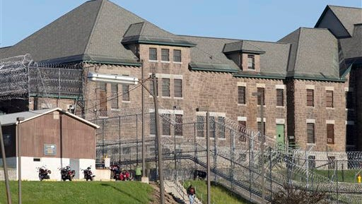 An employee leaves the Clinton Correctional Facility, Wednesday, June 17, 2015 in Dannemora, N.Y. Search teams are back in the woods of northern New York looking for two convicted murderers who broke out of the maximum-security prison a week and a half ago. More than 800 law enforcement officers are in the 12th day of searching for David Sweat and Richard Matt. (AP Photo/Mark Lennihan)