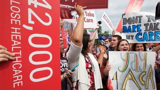 """Jessica Ellis, right, with """"yay 4 ACA"""" sign, and other supporters of the Affordable Care Act, react with cheers to the Supreme Court's decision on Thursday."""