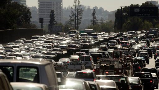 ADVANCE FOR USE FRIDAY, JUNE 26, 2014 AND THEREAFTER - In this Wednesday, May 20, 2015 photo, traffic slowly moves along the 101 Freeway during afternoon rush hour in Los Angeles. Traffic congestion is projected to become significantly worse and more widespread without big changes in how people and products get around. The possible solutions are many, but none is easy or cheap. (AP Photo/Jae C. Hong)