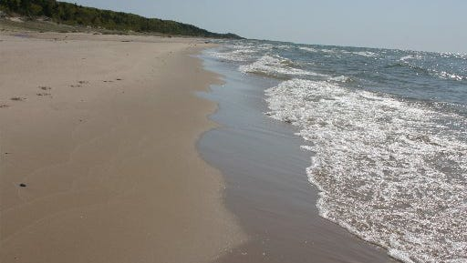 The Nordhouse Dunes National Forest Recreation Area is a federal portion of the beach near Ludington. If you wanted to, you could walk all the way from this beach through Ludington State Park and south.