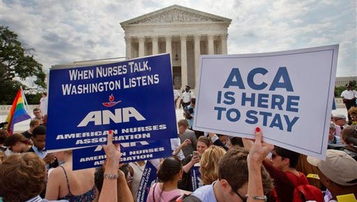 Supporters of the Affordable Care Act hold up signs as the opinion for health care is reported outside of the Supreme Court in Washington, Thursday June 25, 2015. The Supreme Court on Thursday upheld the nationwide tax subsidies under President Barack Obama's health care overhaul, in a ruling that preserves health insurance for millions of Americans. The justices said in a 6-3 ruling that the subsidies that 8.7 million people currently receive to make insurance affordable do not depend on where they live, under the 2010 health care law.  (AP Photo/Jacquelyn Martin)