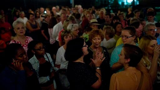 """Literature fans gather in line outside of Ol' Curiosities & Book Shoppe during the midnight book release of """"Go Set a Watchman,"""" in the hometown of """"To Kill a Mockingbird"""" author Harper Lee, Tuesday, July 14, 2015, in Monroeville, Ala. (AP Photo/Brynn Anderson)"""