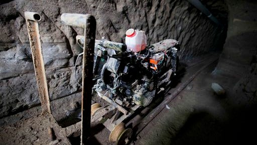 "A motorcycle adapted to a rail is seen under the half-built house where drug lord Joaquin ""El Chapo"" Guzman made his escape through a tunnel from the Altiplano maximum security prison in Almoloya, west of Mexico City, Tuesday, July 14, 2015. A widespread manhunt that included highway checkpoints, stepped up border security and closure of an international airport failed to turn up any trace of ""El Chapo"" Guzman by Monday, more than 24 hours after he escaped through an underground tunnel in his prison cell. (AP Photo/Eduardo Verdugo)"