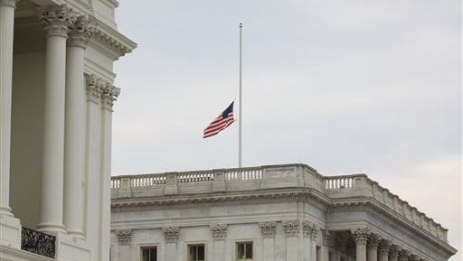 The US flag is seen at half-staff at the Capitol on Tuesday in Washington.