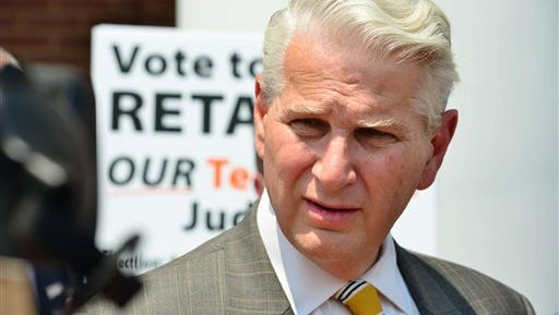 FILE - In this Aug. 5, 2014, file photo, Tennessee Supreme Court Justice Gary Wade speaks to reporters in Blountville, Tenn. Wade, who was a target of an ouster effort lead by Republican state Senate Speaker Ron Ramsey, announced on Friday, July 24, 2015, that he plans to retire in September. (David Grace/The Kingsport Times-News via AP) MANDATORY CREDIT
