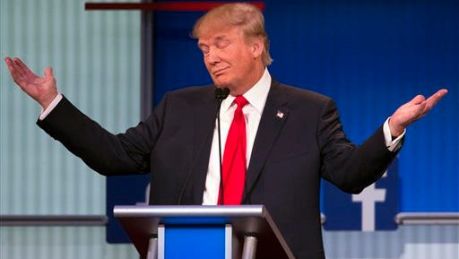 Republican presidential candidate Donald Trump gestures during the first Republican presidential debate on  Thursday in Cleveland.