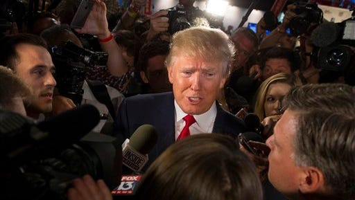 Republican presidential candidate Donald Trump speaks to the media in the spin room after the first Republican presidential debate at the Quicken Loans Arena Thursday, Aug. 6, 2015, in Cleveland. (AP Photo/John Minchillo)