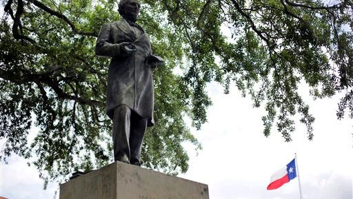 FILE - In this May 5, 2015 file photo, a statue of Jefferson Davis is seen on the University of Texas campus in Austin, Texas. The president of the University of Texas has ordered removing the statue of Davis from the center of campus, but statues of other Confederate figures will stay. The Davis statue has been targeted by vandals and had come under increasing criticism.