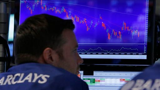 Specialist Frank Masiello works on the floor of the New York Stock Exchange, Thursday, Aug. 20, 2015. The Dow Jones industrial average slid 358 points, 2.1 percent, to 16,990.  (AP Photo/Richard Drew)