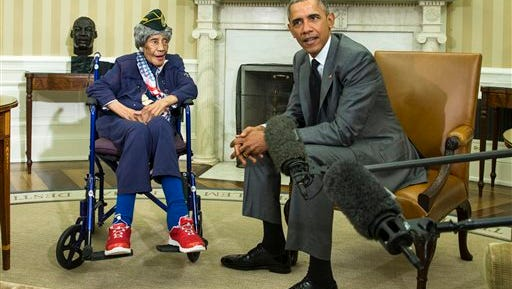 FILE - In this July 17, 2015, file photo, President Barack Obama meets with Emma Didlake, 110, of Detroit, the oldest known World War II veteran, in the Oval Office of the White House in Washington. The Michigan woman who was believed to be the nation's oldest veteran has died a month after meeting the president. The Oakland County medical examiner's office says Didlake died Sunday, Aug. 16 in West Bloomfield, northwest of Detroit.
