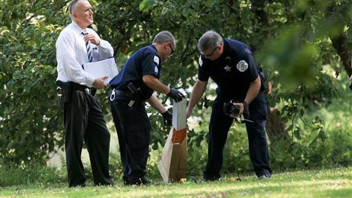 Evidence technicians box evidence found at the Garfield Park lagoon on Sunday, Sept. 6, 2015, in Chicago. Dozens of police officers were searching a lagoon on Chicago's West Side on Sunday where a toddler's decomposed feet and hand were found.