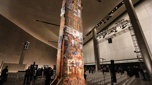 FILE - In this file photo, a steel beam from the World Trade Center stands at the center of the National September 11 Memorial Museum's Foundation Hall before the New York City museum's May 15, 2014, dedication ceremony. Pieces of steel from the twin towers have been parceled out to all 50 states and eight countries for memorials and museum exhibits and were used in the construction of the U.S. Navy ship USS New York. Of 2,200 pieces of steel preserved in an airplane hangar in New York City, there are fewer than 30 left. (John Munson/The Star-Ledger via AP, Pool, File)