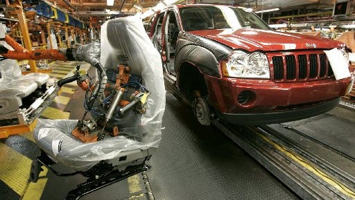 A seat manufactured by Johnson Controls awaits installation into a Jeep Grand Cherokee at the Chrysler Jefferson North assembly plant in Detroit.