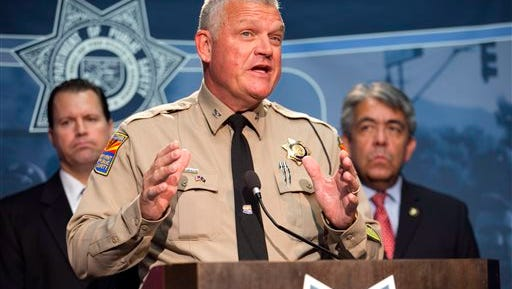 Colonel Frank Milstead, Director of the Department of Public Safety speaks during a press conference to announce the arrest of a suspect in the Phoenix freeway shootings, at DPS headquarters in Phoenix on Friday, Sept. 18, 2015. He is flanked by ATF Special Agent in Charge Tom Attteberry, left, and U.S Marshall for the District of Arizona David Gonzales. (David Wallace/The Arizona Republic via AP)