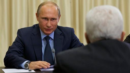 In this Sept. 22 file photo, Russian President Vladimir Putin meets with Palestinian President Mahmoud Abbas, right, in Novo-Ogaryovo residence outside Moscow.