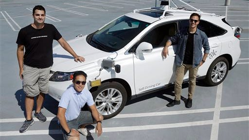 """In this Monday, Aug. 24, 2015 photo, Brian Torcellini, Google team leader of driving operations, right, poses for photos with vehicle safety specialists Rob Miller, top left, and Ryan Espinosa, next to a vehicle at a Google office in Mountain View, Calif. Google employs a few dozen """"safety drivers"""" that grab the steering wheel or hit the brakes on a fleet of robot cars that Google's engineers are programming to navigate the roads without human assistance. (AP Photo/Jeff Chiu)"""