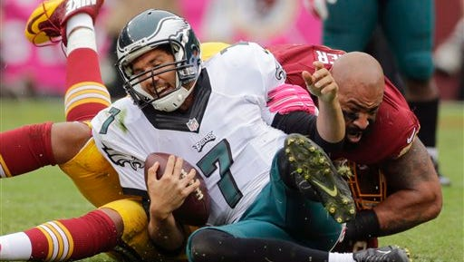 Sam Bradford, shown getting sacked by Washington's Jason Hatcher in an Oct. 4 game, is on pace to throw 20 touchdown passes and 23 interceptions this season.