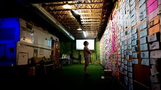 """In this Friday, Aug. 7, 2015 photo, supervising animator Benny Zelkowicz looks at the Big Board while working on the stop-motion animated series """"SuperMansion"""" at Stoopid Buddy Stoodios in Burbank, Calif. Riding on the coattails of Jerry Seinfeld's hit show, """"Comedians in Cars Getting Coffee,"""" Crackle, Sony Pictures' online network, is on track to being profitable, and it's investing in new shows like """"SuperMansion."""" (AP Photo/Jae C. Hong)"""