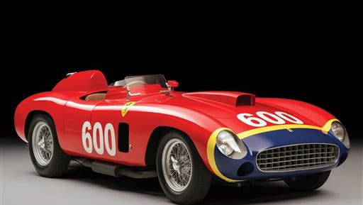 """This undated photo provided by RM Sotheby's in New York shows a 1956 Ferrari 290 MM by Scaglietti, built for Formula One legend Juan Manuel Fangio, that is going on the auction block in New York City where it could sell for more than $28 million. RM Sotheby's says the Ferrari, chassis 0626, will be offered on Dec. 10, 2015, as part of its """"Driven by Disruption"""" sale."""