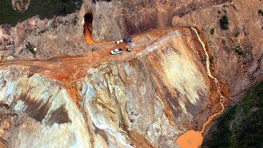 This Aug. 11, 2015 file photo shows waste water continuing to stream out of the Gold King Mine near Silverton, Colo. Government investigators squarely blamed the U.S. Environmental Protection Agency Thursday, Oct. 22, 2015 for a 3 million gallon wastewater spill from a Colorado gold mine, saying an EPA cleanup crew rushed its work and failed to consider the complex engineering involved, triggering the very blowout it hoped to avoid. (Geoff Liesik/The Deseret News via AP, file)  SALT LAKE TRIBUNE OUT; MAGS OUT; MANDATORY CREDIT