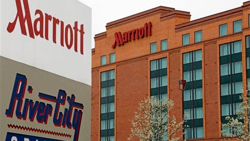 FILE - This Monday, April, 28, 2014, file photo, shows a Marriott hotel in Cranberry Township, Pa. Marriott International announced Monday, Nov. 16, 2015, it is buying rival hotel chain Starwood for $12.2 billion in a deal that will secure its position as the world's largest hotelier. (AP Photo/Gene J. Puskar, File)